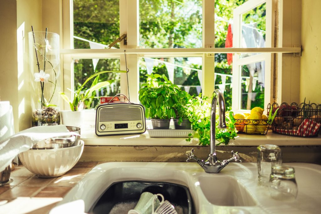 Dishes are in a sink, ready to be washed mindfully.