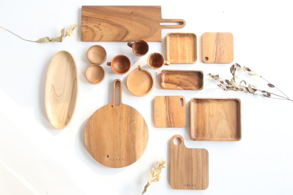Wooden kitchen platters displayed on white backdrop